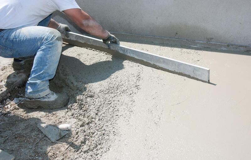 professional concrete contractor working on patio