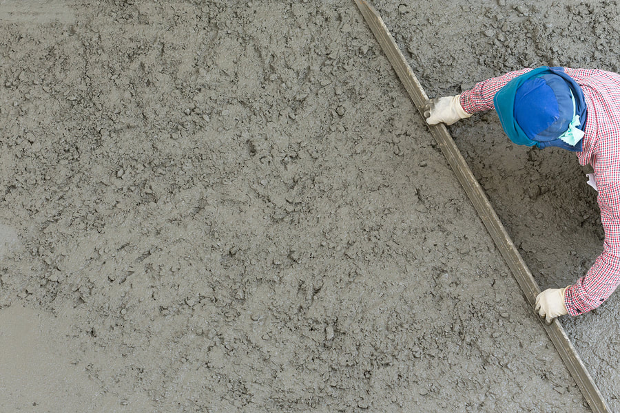 reliable concrete services contractor working on patios