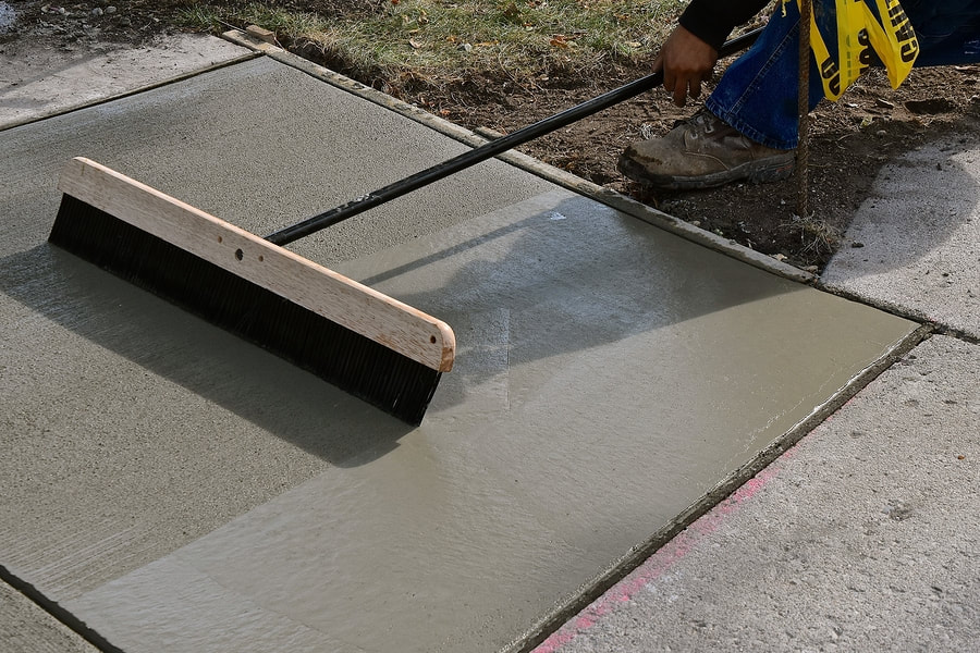 professional concrete contractor working on driveway