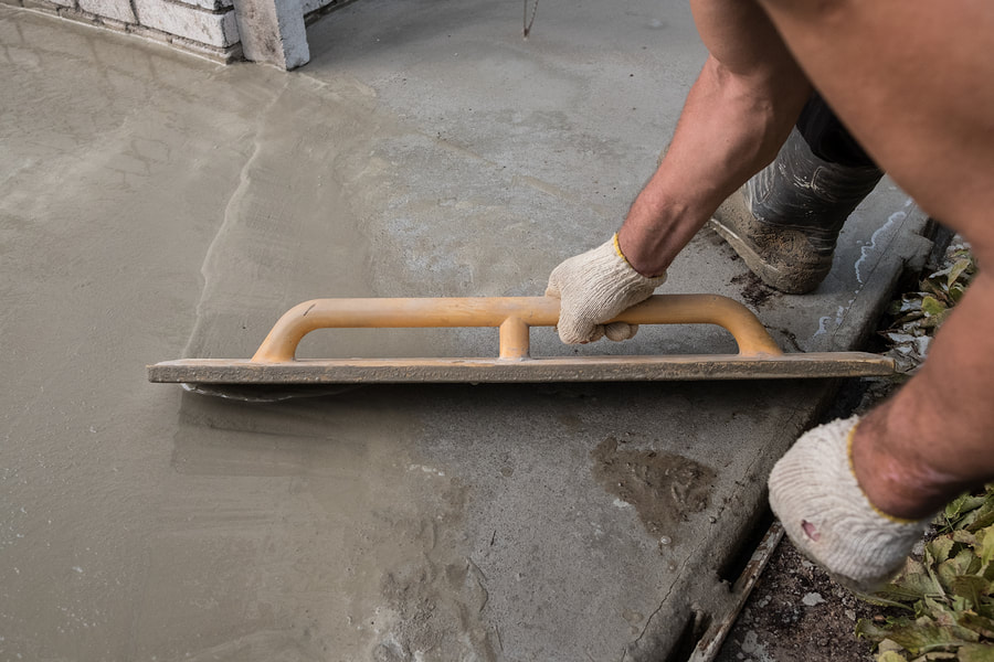 professional concrete contractor working on stamped concrete